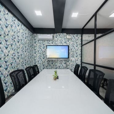 Conference room with premium setup and interactive display.