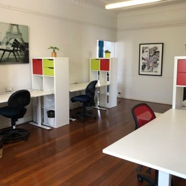 Dedicated desks $450/month, no lease, month to month arrangement, set up your desk with everything you need for as long as you require.